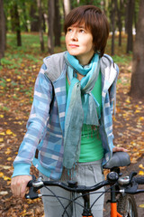 Woman with bicycle in autumn park