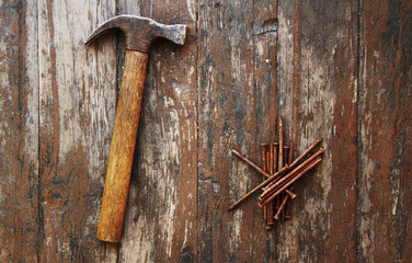 old rusty nails and hammer