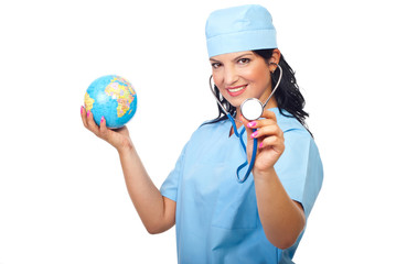 Happy doctor woman with globe and stethoscope