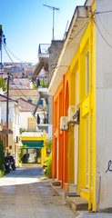 a narrow street surrounded by colorful houses