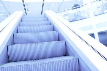 perspective view to moving staircase in metro station