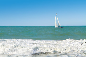 Sailboat On Ocean On Sunny Day