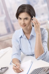 Portrait of businesswoman on phone call