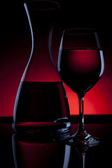 Wine Carafe and Glass on Red