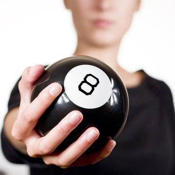 Woman holding 8 black ball