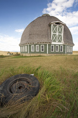 Round barn and tire in foreground.