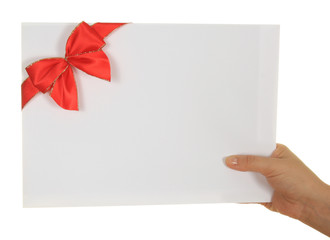 Paper card with red ribbon in woman hand