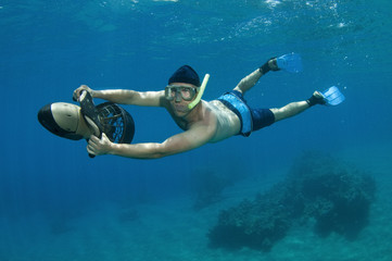 snorkeler on underwater scooter