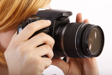 woman with single-lens reflex camera