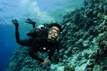 scuba diver on a wall dive
