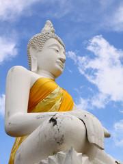 White sitting Budha image with blue sky