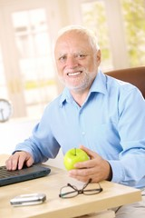 Active senior smiling at home
