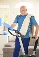 Active senior with fitness equipment