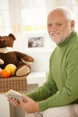 Portrait of grandfather in baby room.