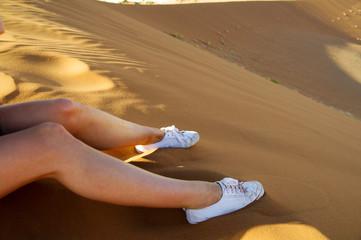 Legs and feet in sand in namib desert