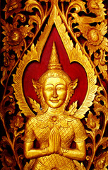Buddha carved gold paint on church door