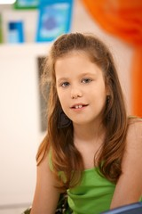 Elementary age schoolgirl smiling