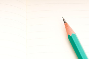 pencil and blank notebook