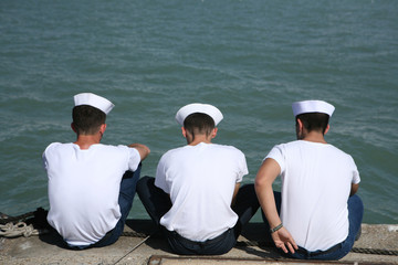 Sailors Sitting at the Docks
