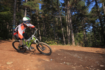 Young man with a helmet riding a mountain bike