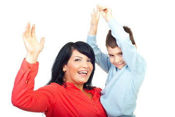 Mother with son raising hands