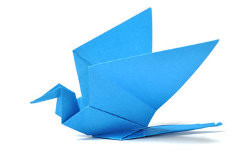 Origami bird over white