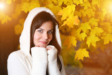 Wall Mural - Beautiful young woman in yellow autumn park