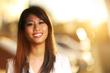 Portrait of beautiful young adult Asian woman outdoor, closeup
