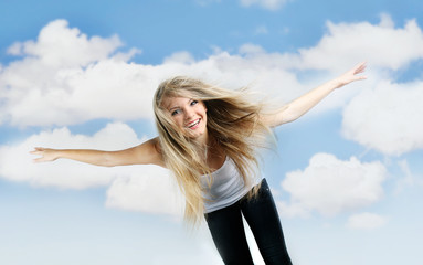 young happy girl flying on sky background