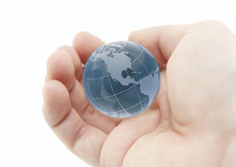 Blue crystal globe in hand with clipping path