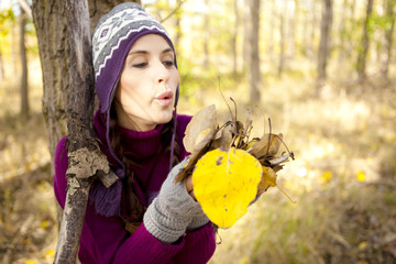 women in the autumn forrest
