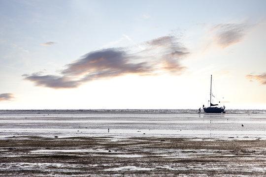 sailboat at low tide