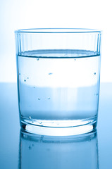 glass with water on glossy background