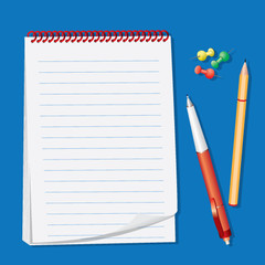Blocknote and pens isolated on a blue background