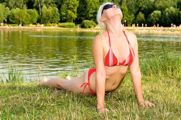 girl in bikini near the pond