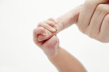 Holding Mommy's finger