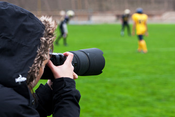 Professional photographer shooting rugby