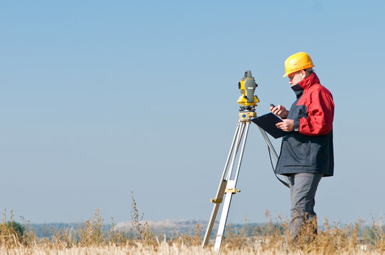 surveyor theodolite worker