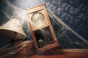 vintage wall clock full of cobwebs