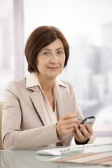 Portrait of female businesswoman with smartphone
