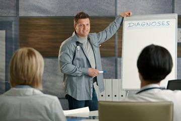 Medical doctors listening to presentation