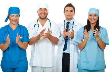Successful team of doctors clapping together