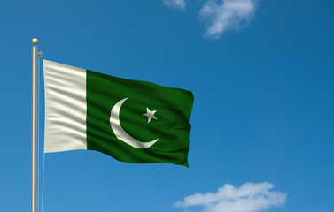 Flag of Pakistan waving in the wind in front of blue sky