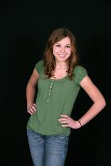 young teen in green shirt