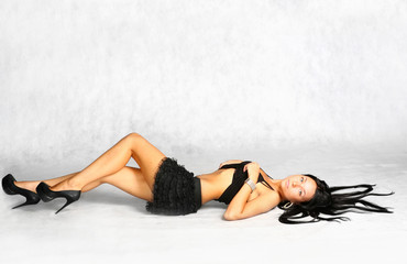 sexy brunette undressing
