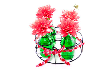 colorful Dahlia flowers in decorated glass vases