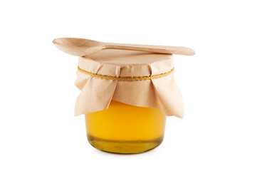 Honey in jar wooden spoon isolated.