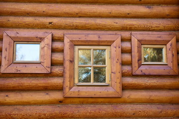 Three windows of old wooden house