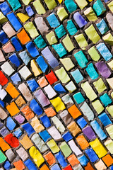 Diagonal colorful mosaic texture on wall