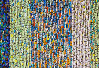 Vertical colorful mosaic texture on wall